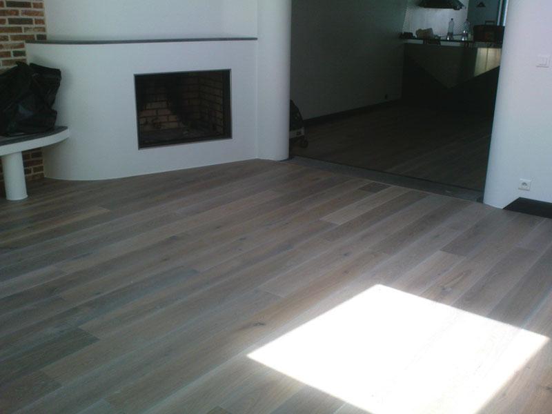 Pose parquet salon chêne provence cheminée